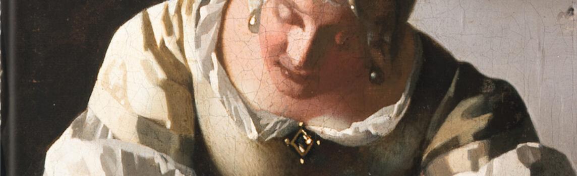 Una dama escribe una carta con su sirvienta